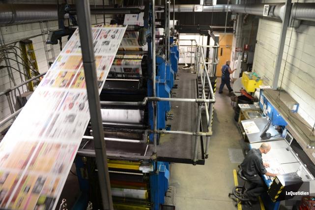 Un bris de nos presses, en pleine impression au cours de la nuit, a forcé la... (PHOTO ARCHIVES LE QUOTIDIEN, JEANNOT LÉVESQUE)