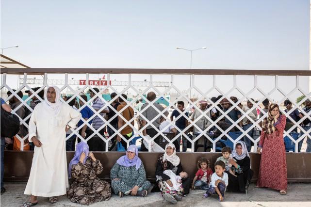 Le gros des réfugiés se trouve dans les... (PHOTO UYGAR ONDER SIMSEK, AFP)