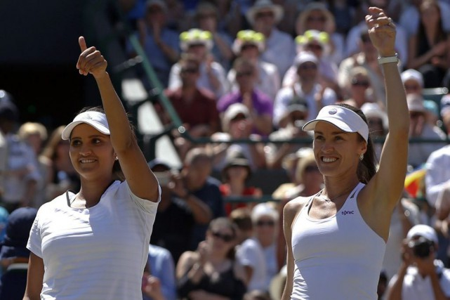 Sania Mirza et Martina Hingis... (Photo Alastair Grant, AP)