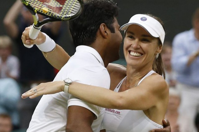 Leander Paes et Martina Hingis... (Photo Alastair Grant, AP)