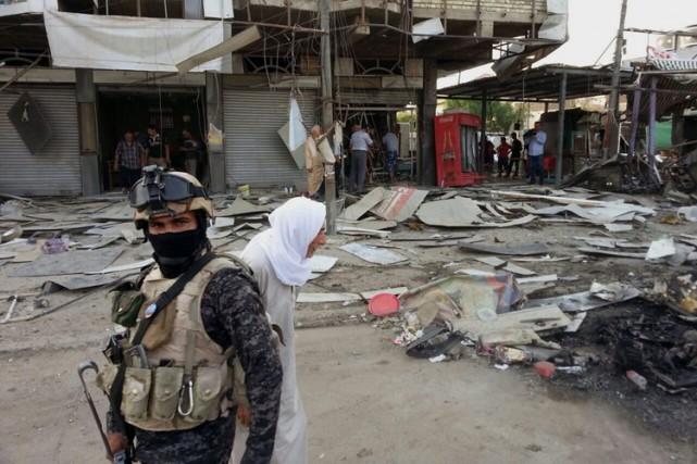 Au moins 21 personnes sont mortes et 62 ont été blessées dimanche à Bagdad dans... (ARCHIVES AP)