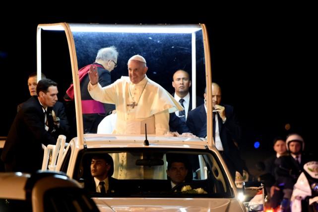 La main tendue aux pauvres et aux oubliés... (PHOTO AFP)