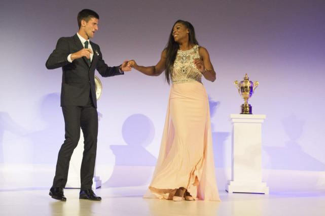 Après avoir remporté un autre titre sur le gazon de Wimbledon, Novak Djokovic... (Agence France-Presse)