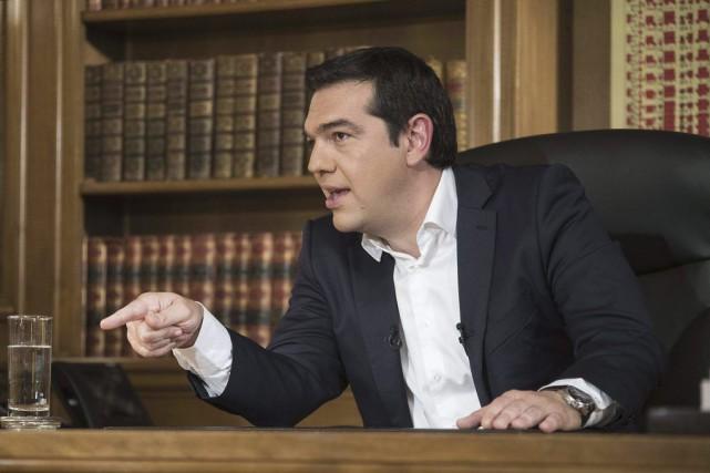 AlexisTsipras a défendu les tactiques de négociations de... (Archives AFP)