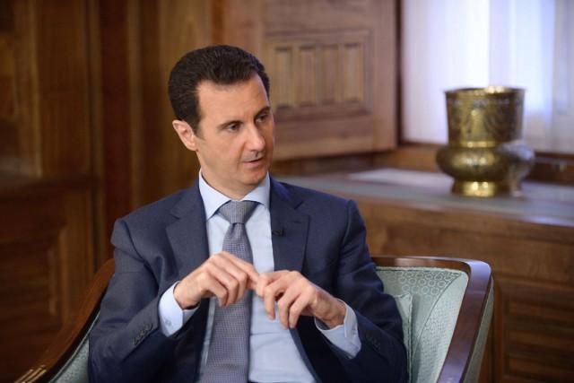 Le général syrien Mohammed Sleiman était très proche... (PHOTO ARCHIVES AFP/SANA)