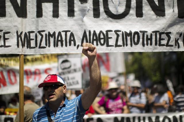 Selon les données de l'OCDE, les Grecs travaillent... (PHOTO EMILIO MORENATTI, AP)