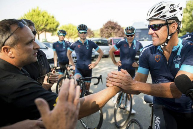Lance Armstrong (à droite).... (PHOTO FRED LANCELOT, REUTERS)