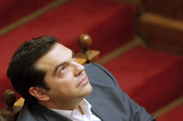 Jeudi, le premier ministre Alexis Tsipras a accepté... (Photo Christian Hartmann, Reuters)