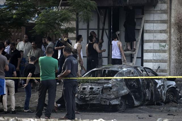 Selon les témoins, des bombes avaient été placées... (PHOTO MOHAMMED ABED, AFP)