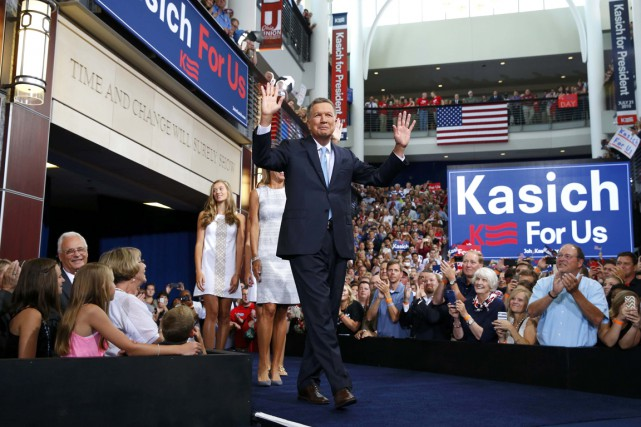 John Kasich... (PHOTO AARON P. BERNSTEIN, REUTERS)
