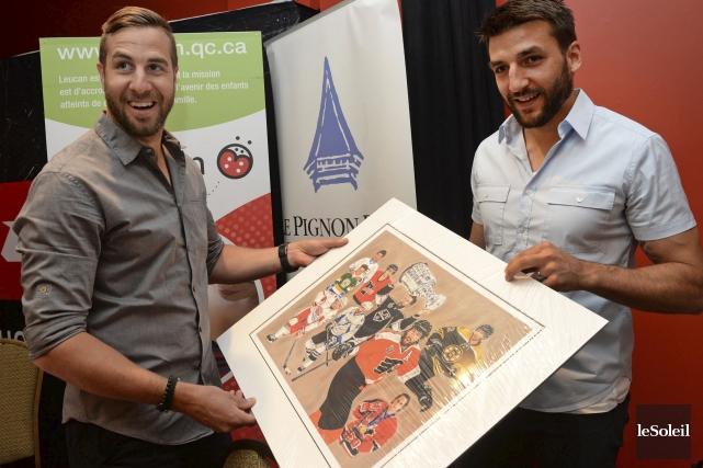 Simon Gagné, à gauche, et Patrice Bergeron ont... (Le Soleil, Patrice Laroche)
