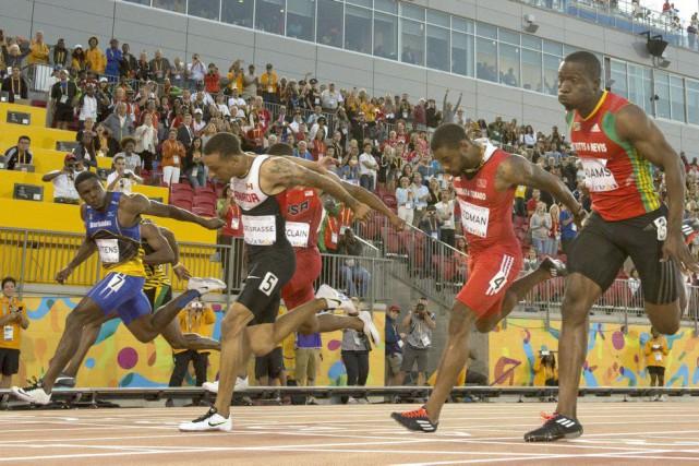 Andre De Grasse (5) a remporté la médaille... (La Presse Canadienne)