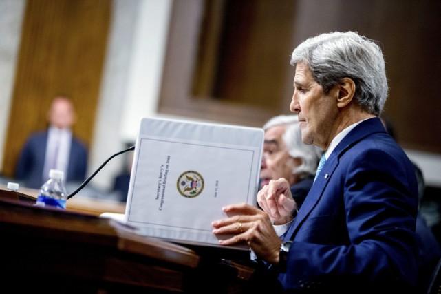 Les sanctions ne peuvent pas seules empêcher l'Iran... (PHOTO ANDREW HARNIK, AP)