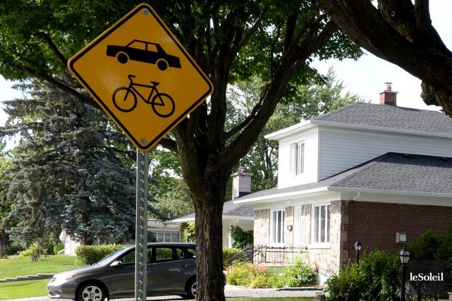 «Et Saguenay impose un règlement aux pauvres cyclistes... (Le Soleil, Erick Labbé)