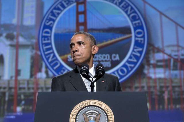 Le président américain a dressé la comparaison entre... (PHOTO CAROLYN KASTER, ARCHIVES AP)