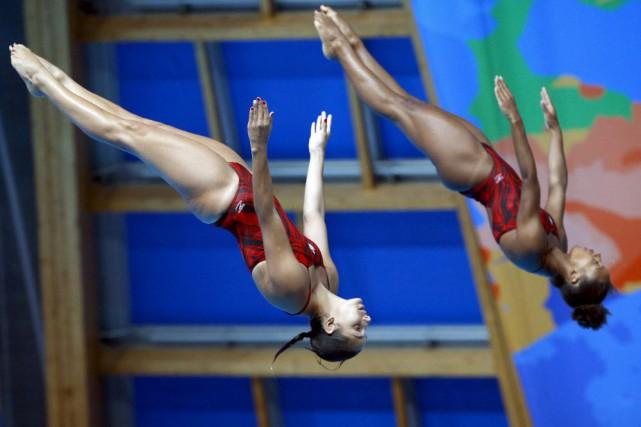 Jennifer Abel et Pamela Ware... (Photo Sergei Grits, AP)
