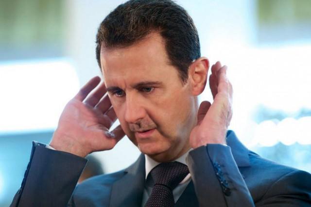 Le président el-Assad a déjà amnistié plusieurs criminels,... (Photo AFP)