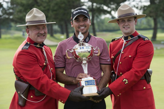 L'Australien Jason Day a empêché David Hearn de... (Paul Chiasson, La Presse Canadienne)