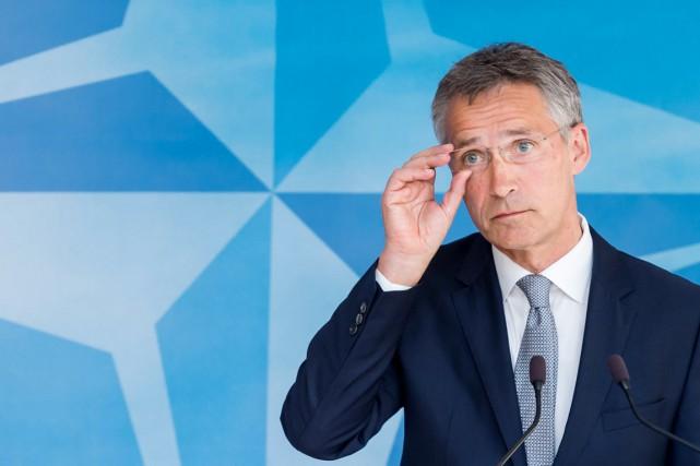 «L'OTAN suit les développements de très près et... (PHOTO GEERT VANDEN WIJNGAERT, AP)