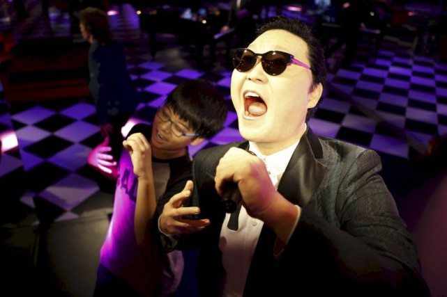La statue de cire du chanteur Psy au... (PHOTO REUTERS)