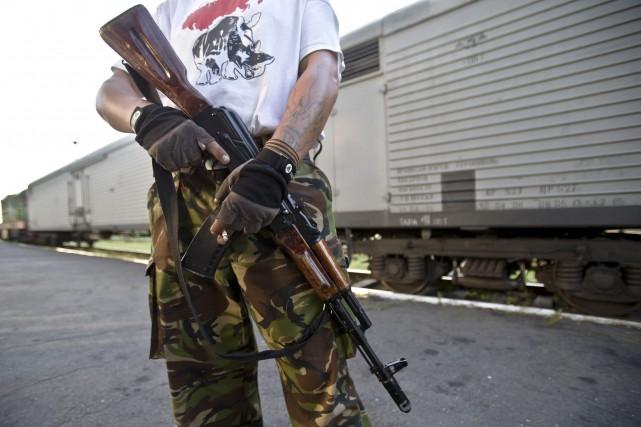 Le conflit opposant l'armée ukrainienne aux rebelles prorusses... (PHOTO ARCHIVES AP)