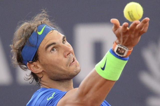 Le favori Rafael Nadal a peiné avant de vaincre Jiri Vesely 6-4, 7-6 (2), hier,... (Agence France-Presse)