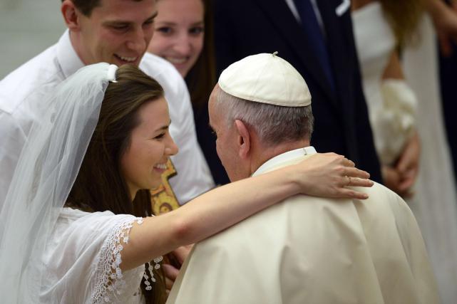 Sans remettre en cause le dogme catholique sur... (PHOTO AFP)