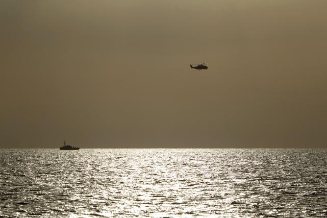 Sept navires participent aux opérations de recherche, soutenus... (Photo Darrin Zammit Lupi, Reuters)