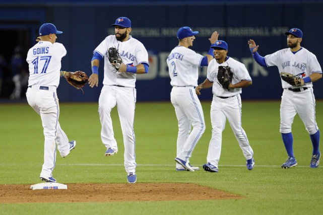Jose Bautista a cogné un grand chelem en deuxième manche, et les Blue Jays ont... (Photo Peter Llewellyn-USA TODAY Sports)