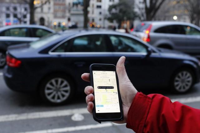 La société Uber déboursera au moins 10 millions de dollars US pour régler une... (Photo ANDREW CABALLERO-REYNOLDS, archives AFP)