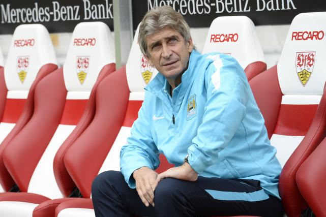 L'entraîneur de Manchester City, Manuel Pellegrini.... (Photo Thomas Kienzle, AFP)