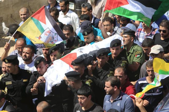 Le corps de Saad Dawabcheh, 32 ans, le... (Photo Abed Omar Qusini, Reuters)