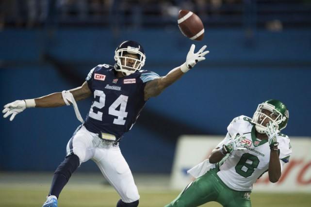 Trevor Harris a lancé deux passes de touché au quatrième quart pour aider les... (Photo Frank Gunn, La Presse canadienne)