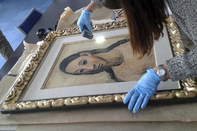Un tableau de Picasso, Tête de jeune fille,... (PHOTO AFP)