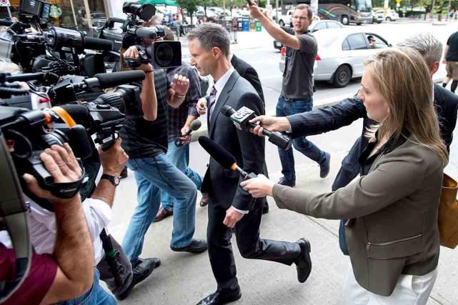 Nigel Wright à sa sortie de cour... (La Presse Canadienne)