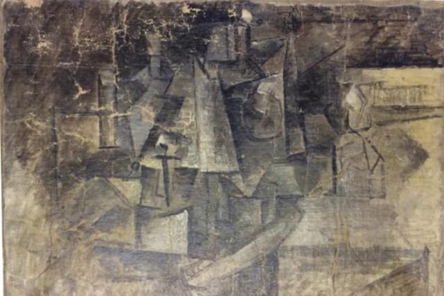 La Coiffeusedate de l'époque cubiste du peintre espagnol... (PHOTO AP)