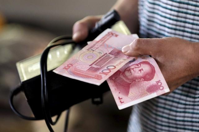 Pékin continue d'encadrer étroitement la convertibilité du yuan,... (PHOTOJASON LEE, ARCHIVES REUTERS)