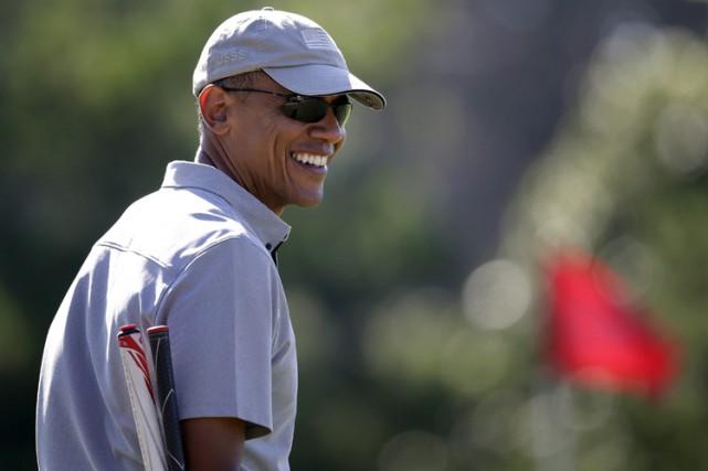 Barack Obama s'est permis une joute de golf... (PHOTO AP)