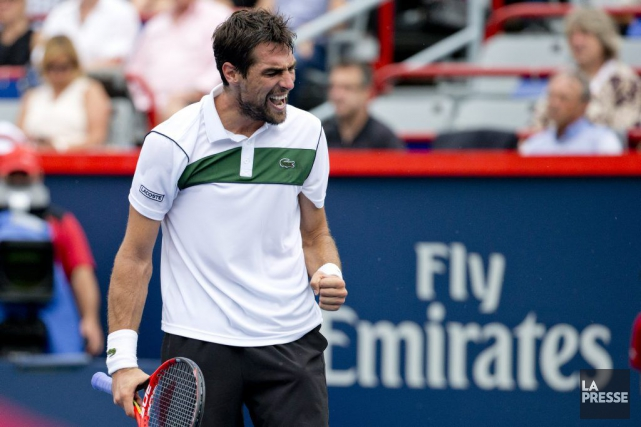Jérémy Chardy a repoussé sept balles de match, dont... (PHOTO DAVID BOILY, LA PRESSE)