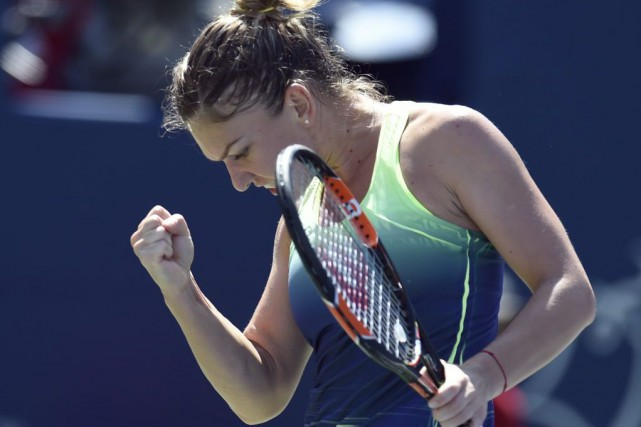 Simona Halep... (PHOTO Geoff Robins, AFP)