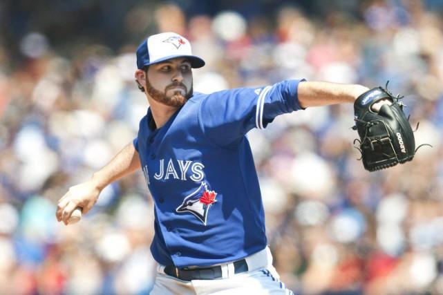 Drew Hutchison a alloué trois coups sûrs en... (La Presse Canadienne)