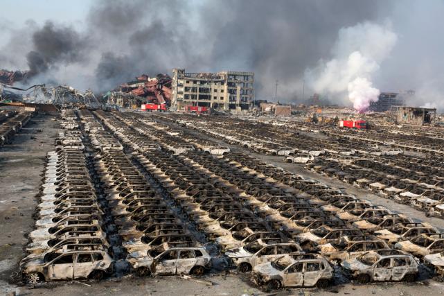 Les explosions dans la ville de Tianjin, en... (Photo Ng Han Guan, AP)