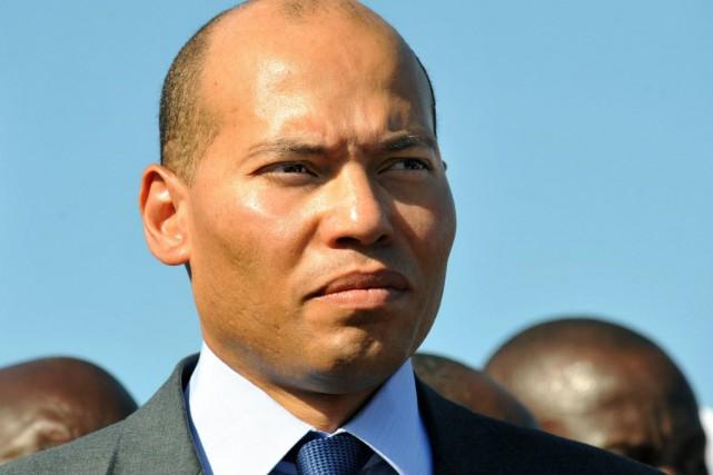 Karim Wade, fils de l'ancien président sénégalais (2000-2012),... (Photo GEORGES GOBET, AFP)