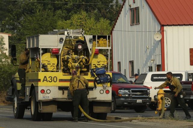 Plusieurs feux faisaient rage dans l'État de Washington... (Photo Ted S. Warren, AP)