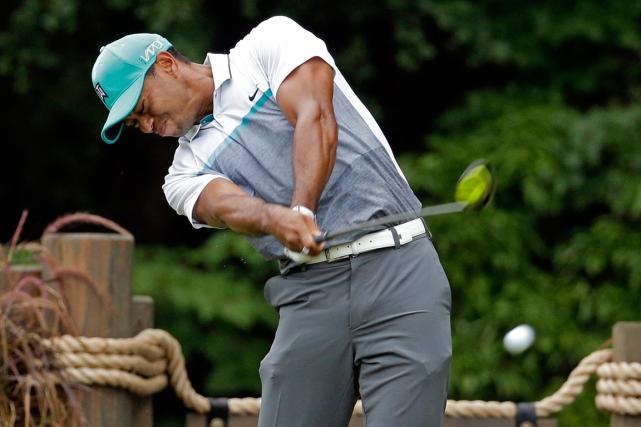 Tiger Woods... (Photo Chuck Burton, AP)
