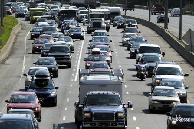 Les bouchons de circulation font partie du quotidien... (Archives La Presse)
