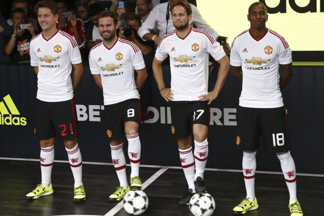 Ander Herrera, Juan Mata, Daley Blind et Ashley... (PHOTO JUSTIN TALLIS, AFP)