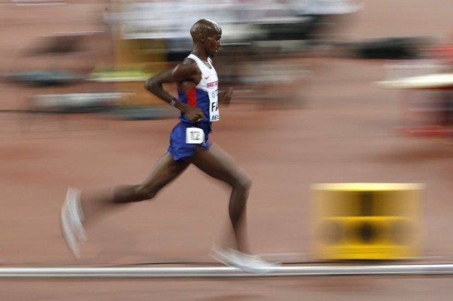 Mo Farah... (PHOTO DAVID GRAY, REUTERS)