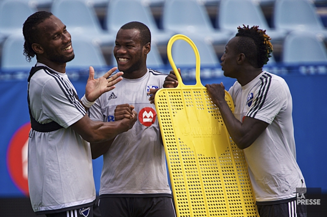 Didier Drogba, Romario Williams et Dominic Oduro lors... (Photo André Pichette, La Presse)