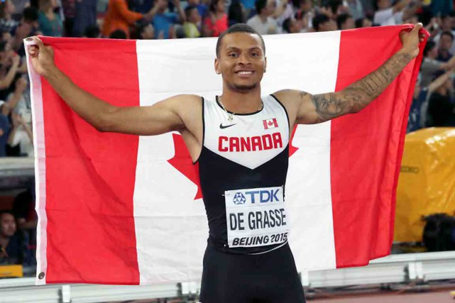 Andre De Grasse... (Photo Lee Jin-man, archives AP)